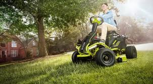 Electric Lawn Mower In Use